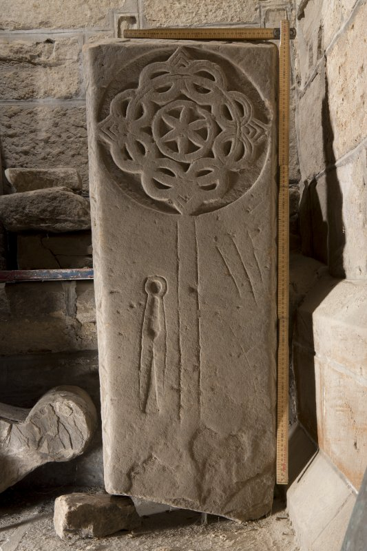 Obliquely lit view of medieval cross slab (with slab).