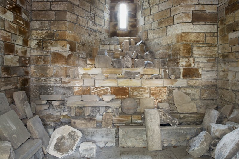 View of carved stones and fragments in ground floor of tower.