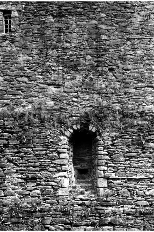Detail of West wall of Keep showing window embrasure at first floor level and blocked embrasure at second floor level