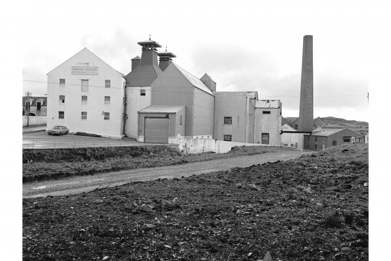 Islay, Lagavulin Distillery View from WSW showing WSW front of malt barns and kilns with chimney in background