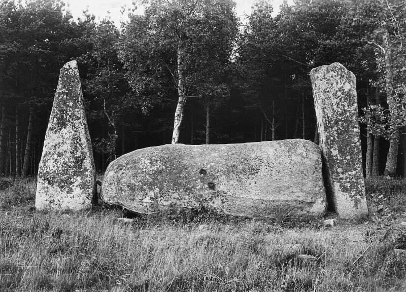 """View of recumbent stone and pillars from the south, with two markings on the recumbent stone. Original negative captioned 'Cothiemuir Stone Circle, Keig. Recumbent Stone showing """"Devil's Hoofprints"""" 1910'."""