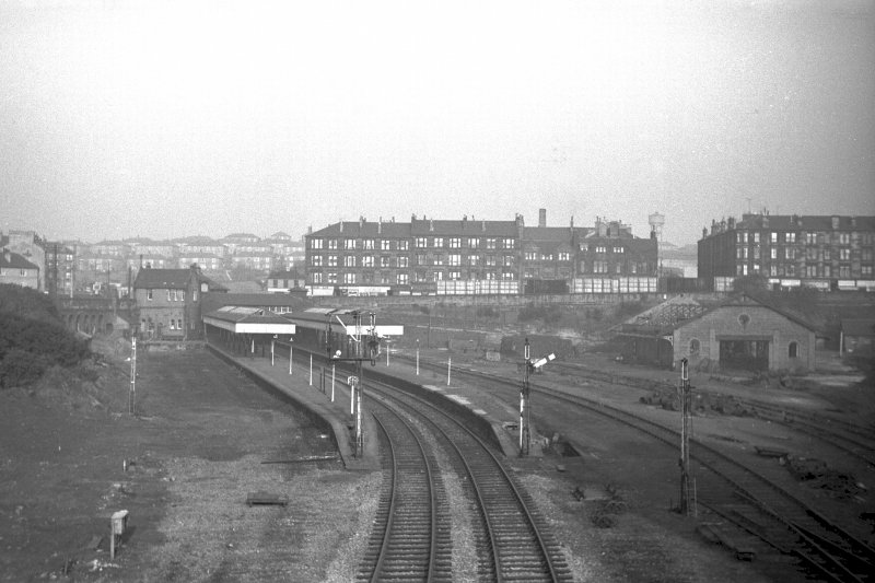 General view from WSW showing station with tenements and Soldiers Home in background and goods shed on right