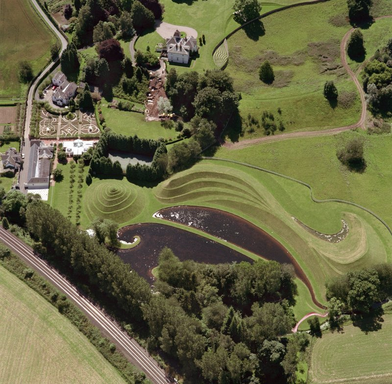 Oblique aerial view of house and garden.