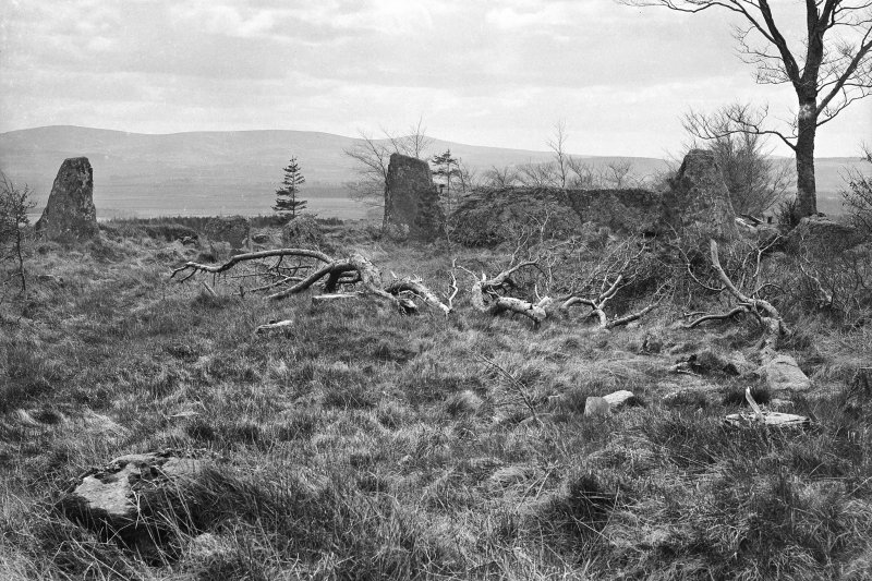View of recumbent, flankers, and western stone of circle. Original negative captioned 'Old Keig Stone Circle view from inside circle looking South 1908'.