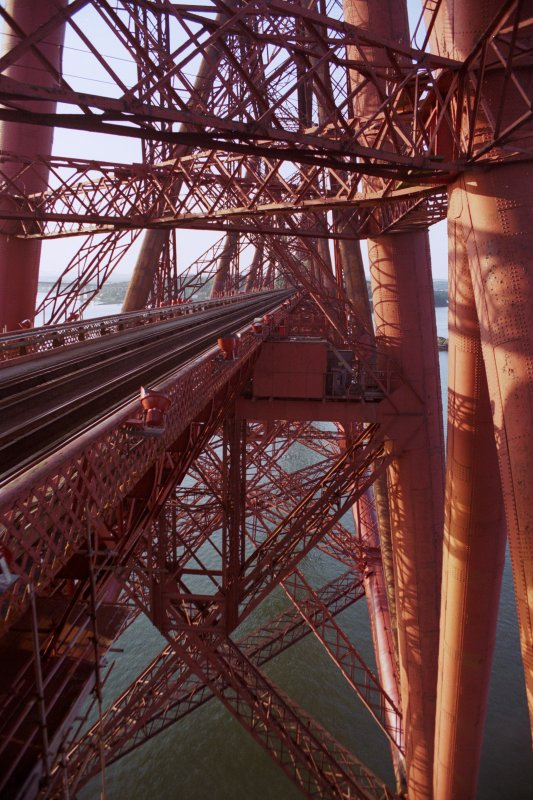Forth Bridge: View within south cantilever showing the deck and track (left), and the full width of the bridge