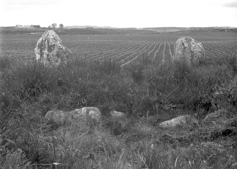 Detail of cairn and northern stones. Original negative captioned: 'Cullerlie Circle on farm of Standing Stones, near Garlogie, Echt. Stone Setting and 2 northern stones, viewed from South July 1902'.