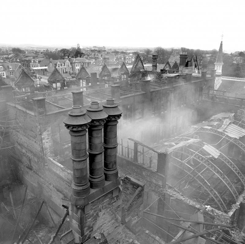 View of triple chimney stack and central block from elevated platform (after fire), Morgan Academy, Dundee.