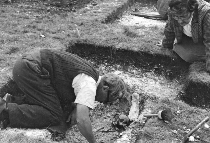 Digital copy of view of Brian Hope-Tayor excavating a grave, excavations by Brian Hope-Taylor 1948-49. Digital image only