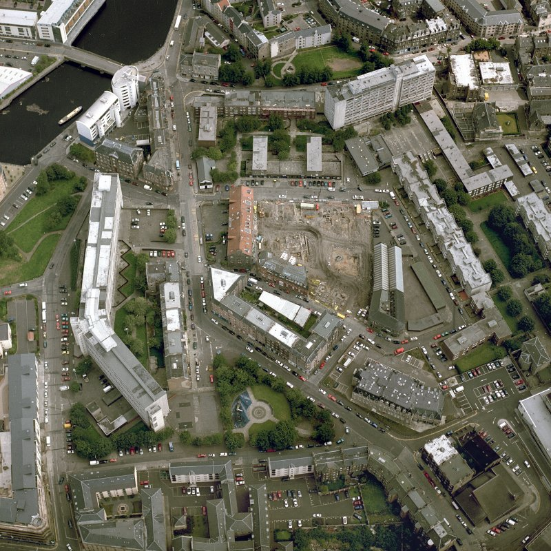 Oblique aerial view centred on the excavation of the Black Vaults, Edinburgh, with the warehouses and offices adjacent, taken from the SW.