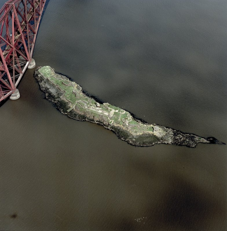 Scanned image of oblique aerial view of The Forth Bridge and Inch Garvie centred on the rail bridge and the remains of a castle, battery, coast battery and artillery fortifications, taken from the SSE.