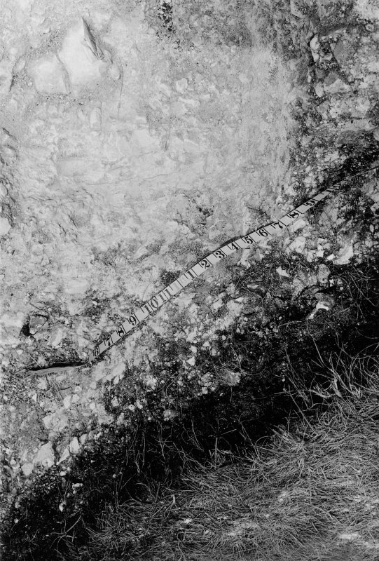 Digital copy of excavation photograph: detail of trench.
