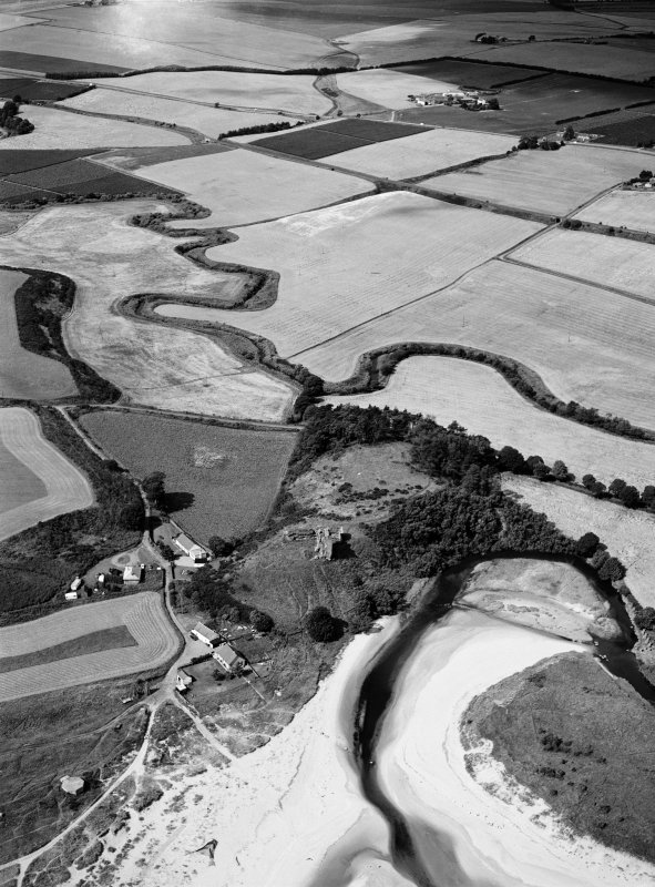 Oblique aerial view centred on the remains of Red Castle, Lunan, looking to the WNW.
