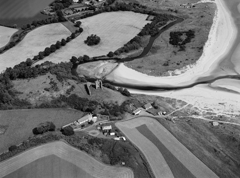 Oblique aerial view centred on the remains of Red Castle, Lunan, looking to the NNW.