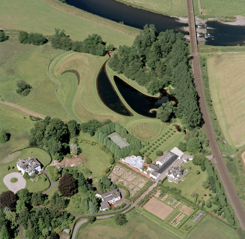 Oblique aerial view centred on the garden and country house, taken from the SSE.