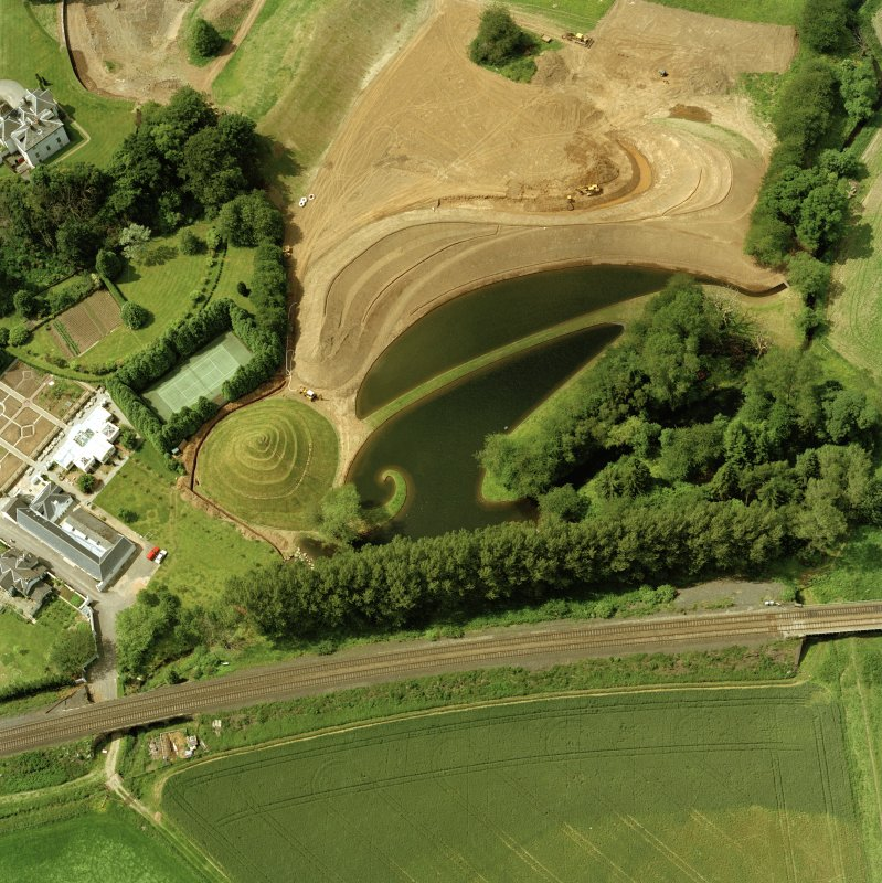Oblique aerial view centred on Portrach House garden.