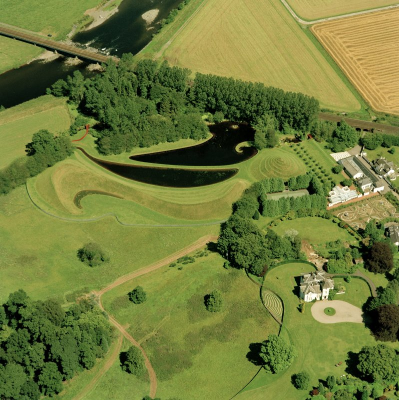 Oblique aerial view centred on Portrack House and country house, taken from the SW.