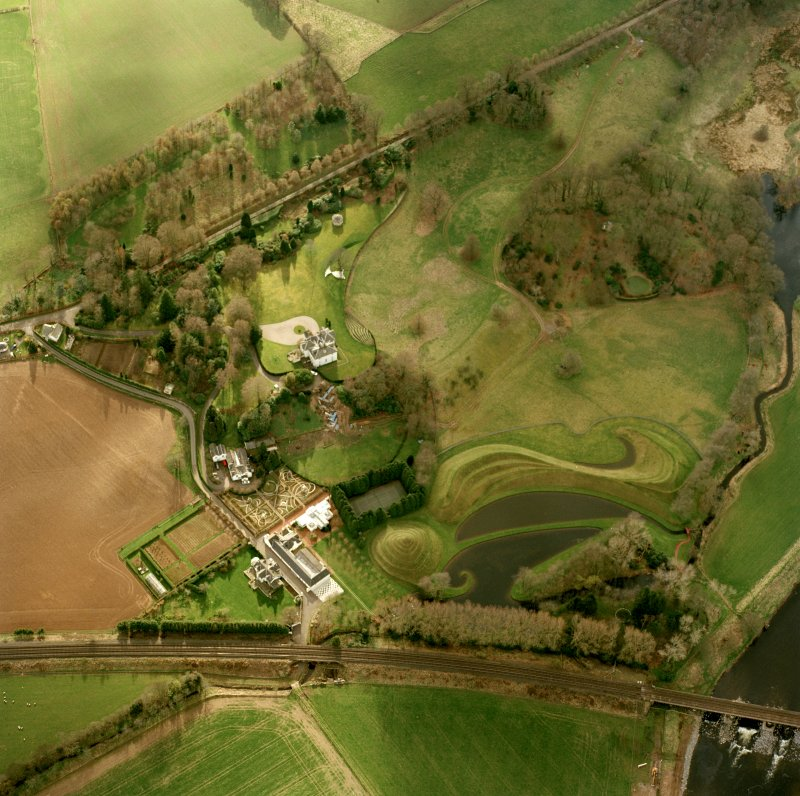 Oblique aerial view centred on Portrack House and garden, taken from the ENE.