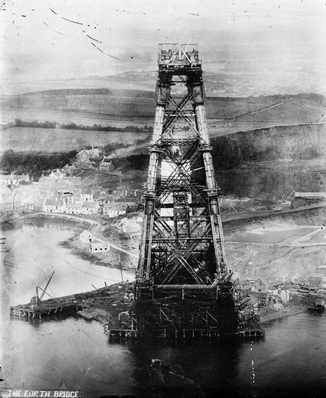 View of the bridge under construction looking from the top of one cantilever to the next. Insc. 'The Forth Bridge.'