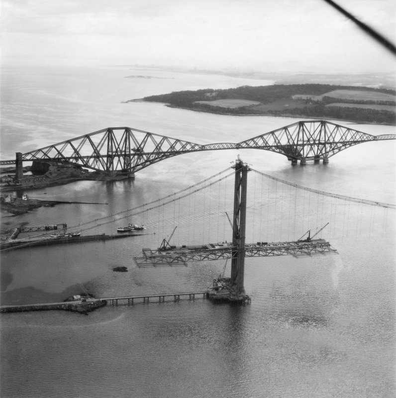 Oblique aerial view of Forth Road Bridge under construction.