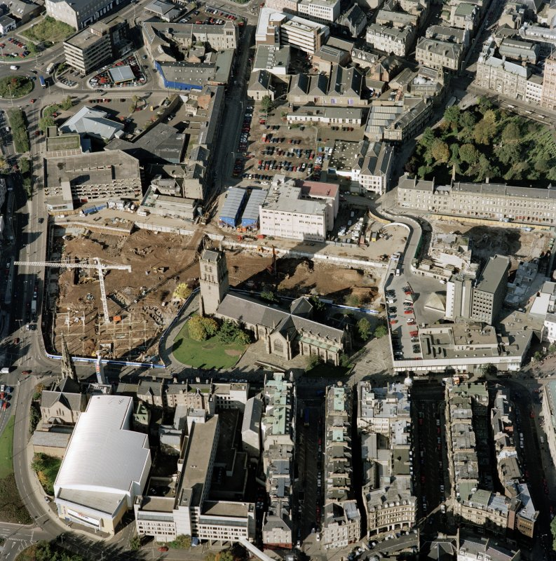 Oblique aerial view centred on the City Churches, Nethergate and adjacent construction, taken from the SE.