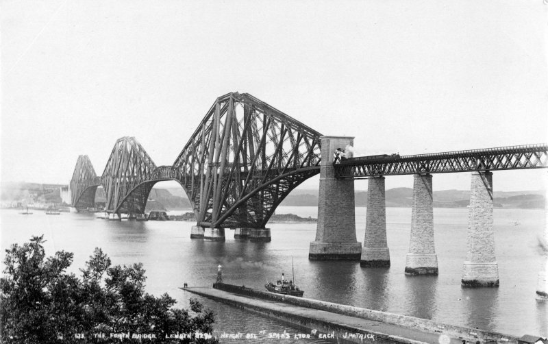 General view of the Forth Bridge in use seen from the South West. Insc. '673 The Forth Bridge. Length 8296 Ft, height 354 Ft, spans 1,700 Ft each.  J. Patrick.'