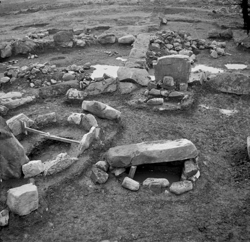 View of Cist A with capstone still in situ and Cist B with capstone removed at excavation of Cairnpapple henge and cairn, by Professor S Piggott.
