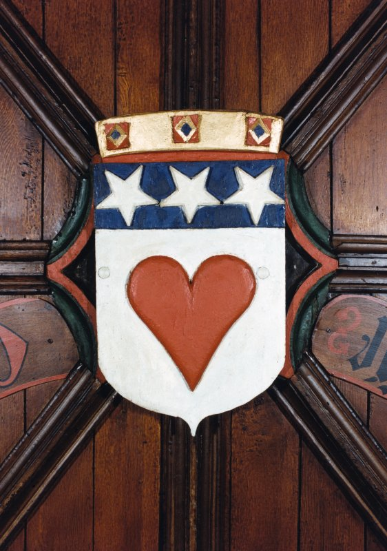 Detail of the Heraldic Shield of the arms of the Earl of Douglas at St Machar's Cathedral, Chanonry, Aberdeen. Shield: Argent, a human heart gules, on a chief azure three stars of the field.