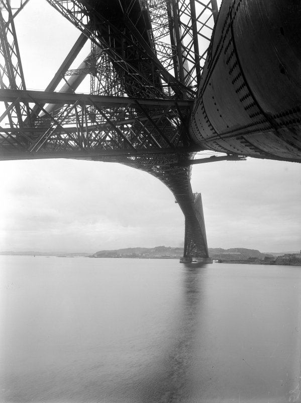 View across the Forth looking up from underneath the Forth Bridge showing the structure.