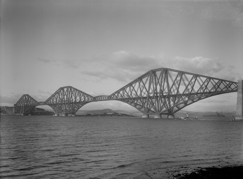 View of the bridge from the South East shore. With HMS Nelson or Rodney on horizon.