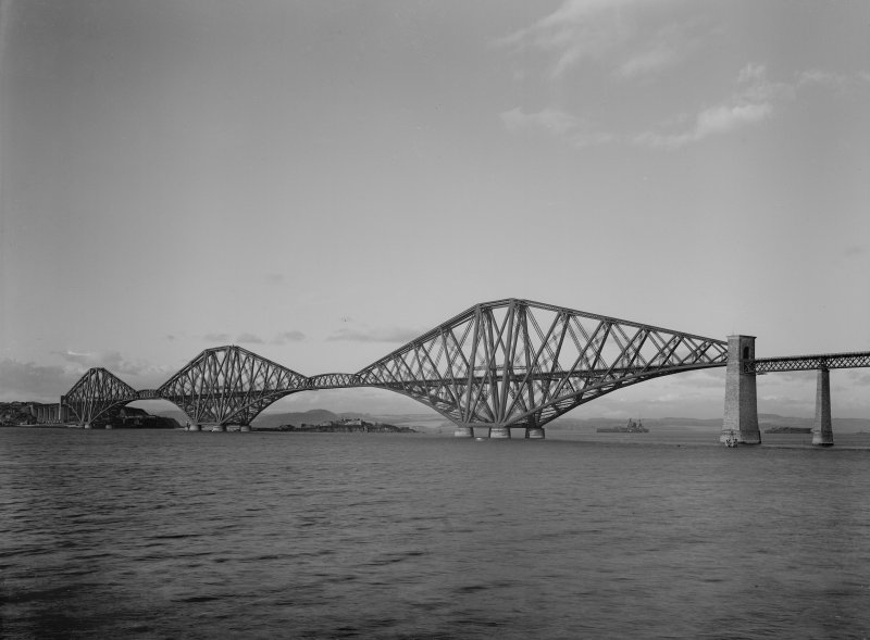 General view of the bridge from the South West shore. With HMS Nelson or Rodney on horizon.