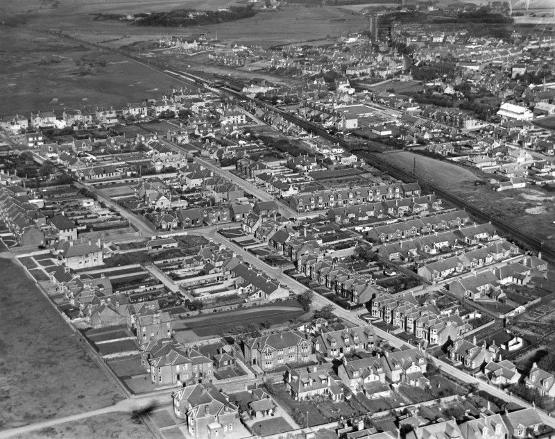 Prestwick, general view, showing Prestwick Station and Marina Road.  Oblique aerial photograph taken facing north-east.