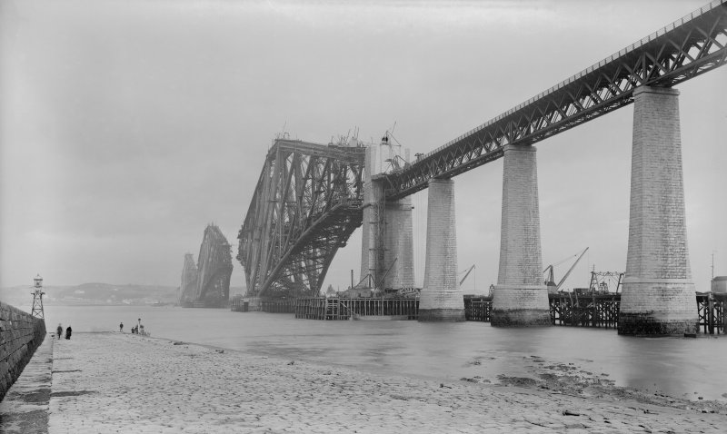 View of the Forth Bridge under construction seen from the South West shore.