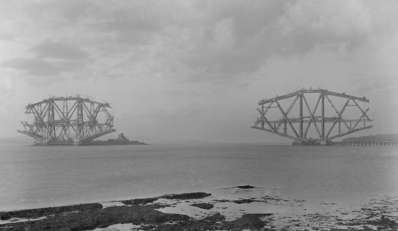 View of the Forth Bridge under construction seen from the West shore of South Queensferry.