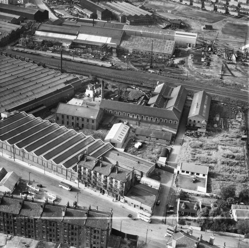 British Dyewood Co. Ltd. Carntyne Dyewood Mills, Shettleston Road and Parkhead Crane Works, Rigby Street, Glasgow.  Oblique aerial photograph taken facing north.  This image has been produced from a crop marked negative.