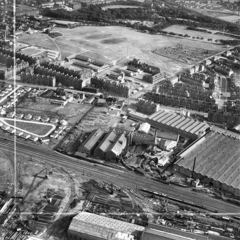 British Dyewood Co. Ltd. Carntyne Dyewood Mills, Shettleston Road and Tollcross Park, Glasgow.  Oblique aerial photograph taken facing south.  This image has been produced from a crop marked negative.
