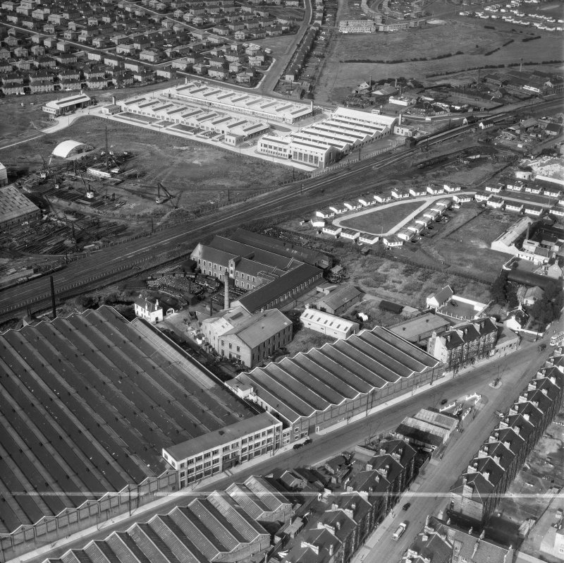 Glasgow, general view, showing British Dyewood Co. Ltd. Carntyne Dyewood Mills, Shettleston Road and Carntyne Station.  Oblique aerial photograph taken facing north-east.  This image has been produced from a crop marked negative.