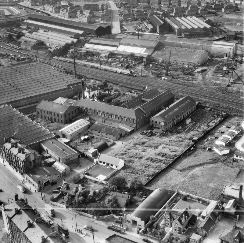 British Dyewood Co. Ltd. Carntyne Dyewood Mills, Shettleston Road and Parkhead Crane Works, Rigby Street, Glasgow.  Oblique aerial photograph taken facing north-west.  This image has been produced from a crop marked negative.