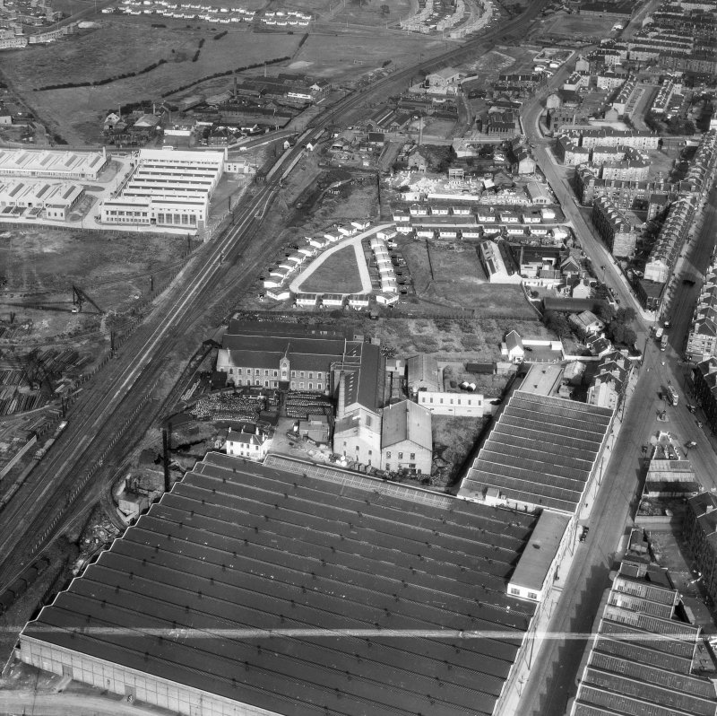 Glasgow, general view, showing British Dyewood Co. Ltd. Carntyne Dyewood Mills, Shettleston Road and Carntyne Station.  Oblique aerial photograph taken facing east.  This image has been produced from a crop marked negative.