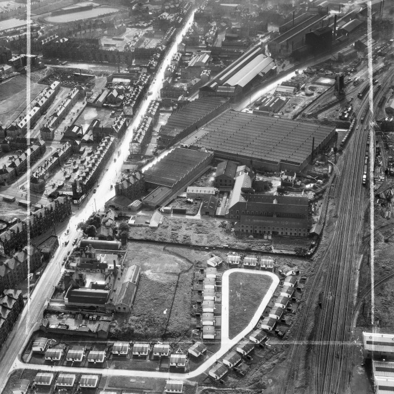 Glasgow, general view, showing British Dyewood Co. Ltd. Carntyne Dyewood Mills, Shettleston Road and Westmuir Street.  Oblique aerial photograph taken facing west.  This image has been produced from a crop marked negative.