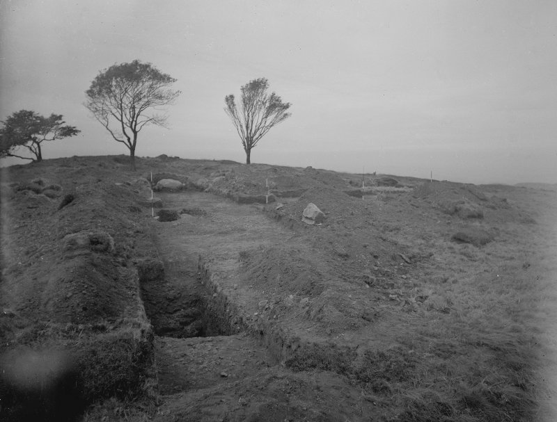 Cairnpapple Hill,  photograph of excavation showing henge ditch from ESE.