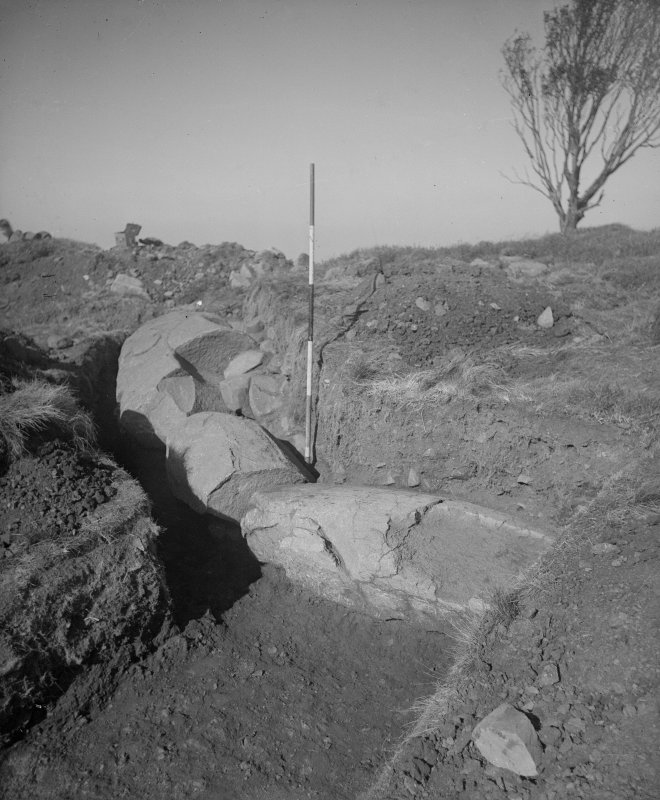 Cairnpapple Hill, photograph of excavation showing kerb stones of Period III cairn on SW.