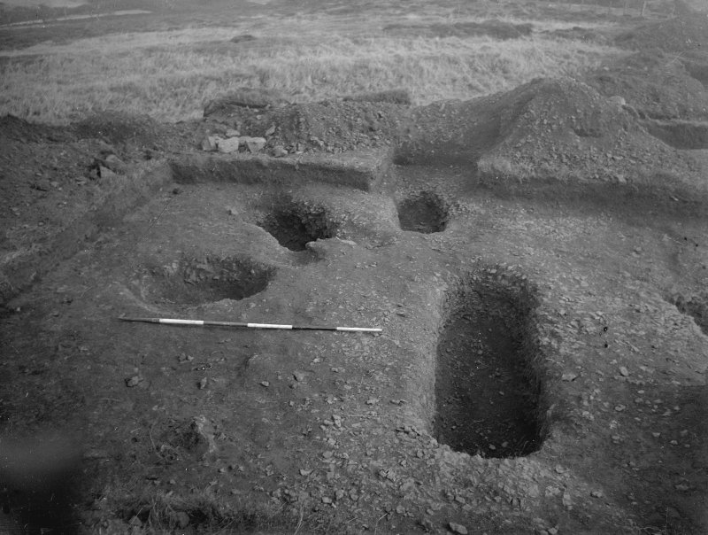 Cairnpapple Hill, photograph of excavation showing stone-hole 8, Beaker grave and Inhumation graves 3-4.