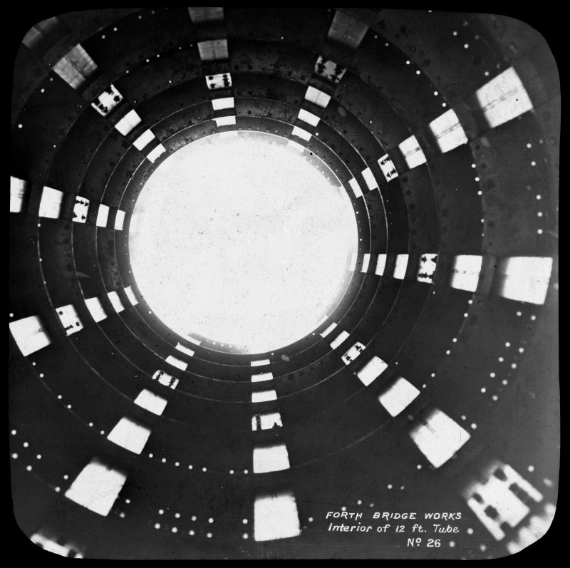 View inside one of the 12 feet tubular members. Insc. 'Forth Bridge Works. Interior of 12 ft. Tube. No. 26.' Lantern slide.