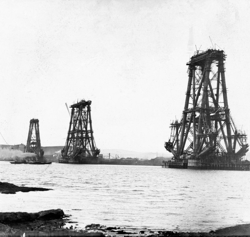 View of the three cantilevers in the early stages of construction seen from the South West shore. Insc. '132'. Lantern slide.