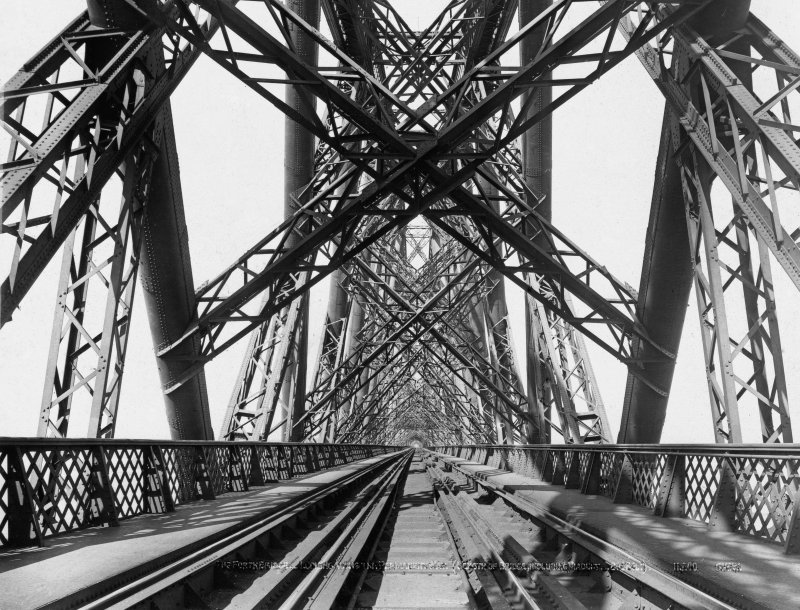"View along the tracks through the structure of the bridge. Insc. '49 Forth Bridge - The Permanent Way. ""Auld Reekie"" G.W.W.' Lantern slide."