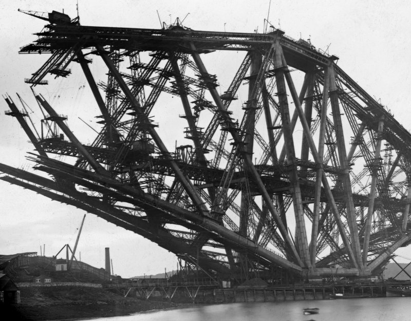 View of the Fife erection under construction seen from the Fife shore. Insc. 'North Tower, Forth Bridge. 6790. G.W.W. Height - 369 ft.' Mount insc. 'Forth Bridge. G.W.W.' Lantern slide.