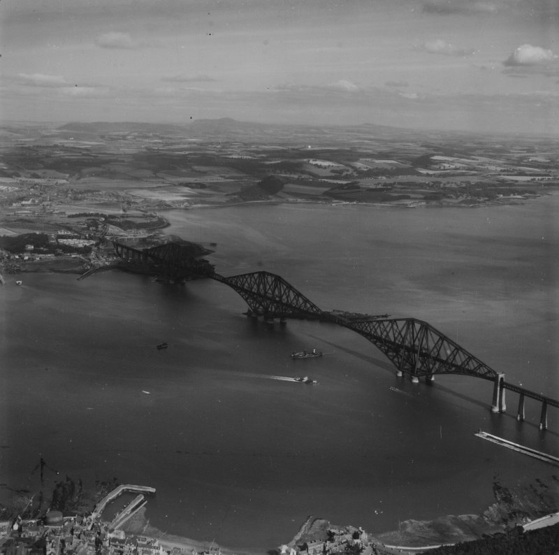 Forth Rail Bridge and Inverkeithing Bay, Firth of Forth.  Oblique aerial photograph taken facing north.  This image has been produced from a print.