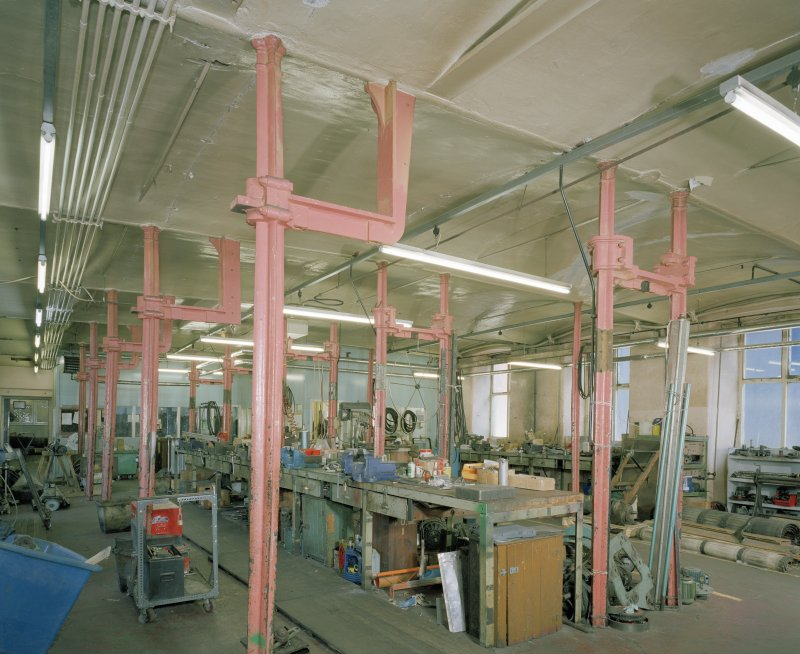 Interior.  Ground floor workshop area from S