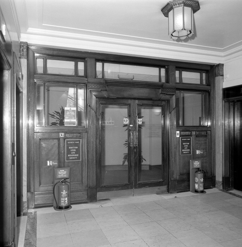 Interior. 7th floor Detail of entrance doors from stair hall