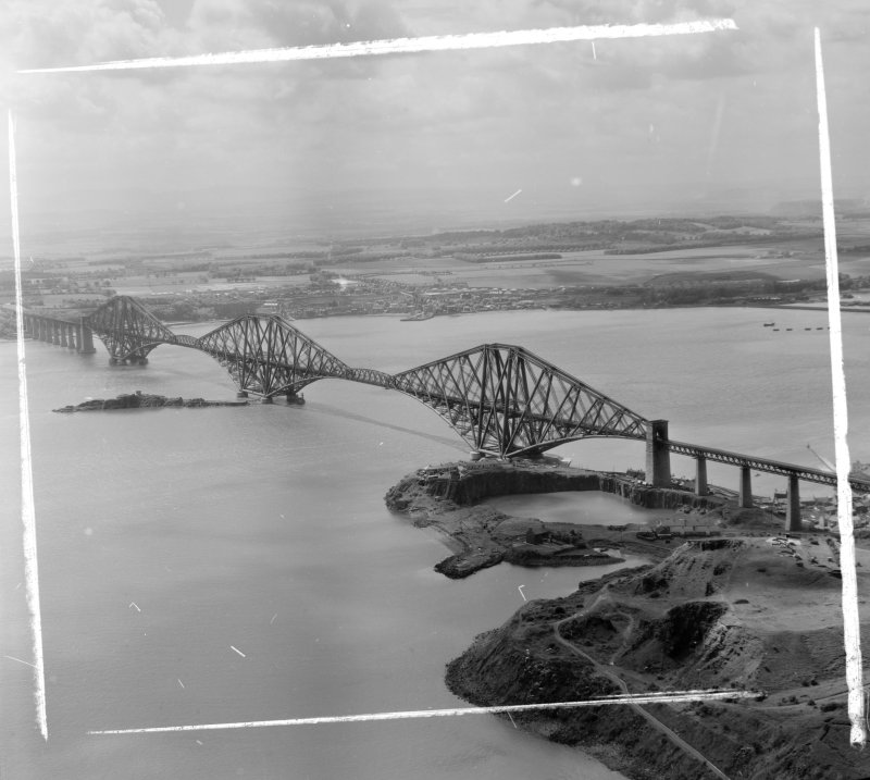 Forth Bridge from North/East Inverkeithing, Fife, Scotland. Oblique aerial photograph taken facing South/West. This image was marked by AeroPictorial Ltd for photo editing.
